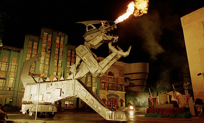 In 1992, the fire-breathing Robosaurus arrives to chomp clunkers, chew rustbuckets and spit hot metal!