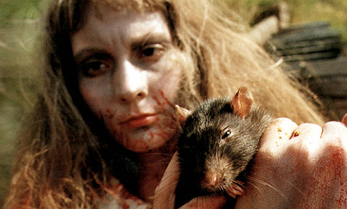 Trapped under glass and covered with live rats, The Rat Lady is seen for the very first time...